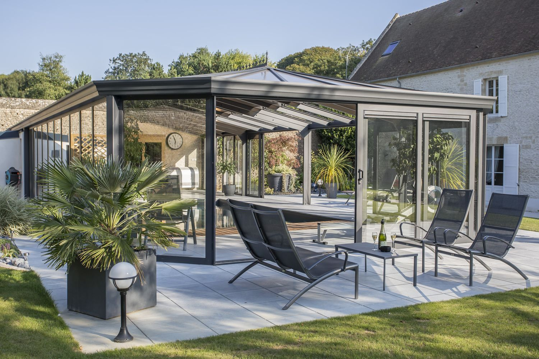 Véranda à toit ouvrant en double vitrage et polycarbonate | Cover Concept