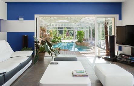Véranda pour piscine xxl en extension d'habitation