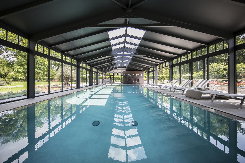 Piscine couloir de nage couverte par une véranda Cover Concept