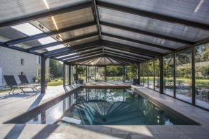 Piscine couverte par une véranda pour piscine en double vitrage et polycarbonate