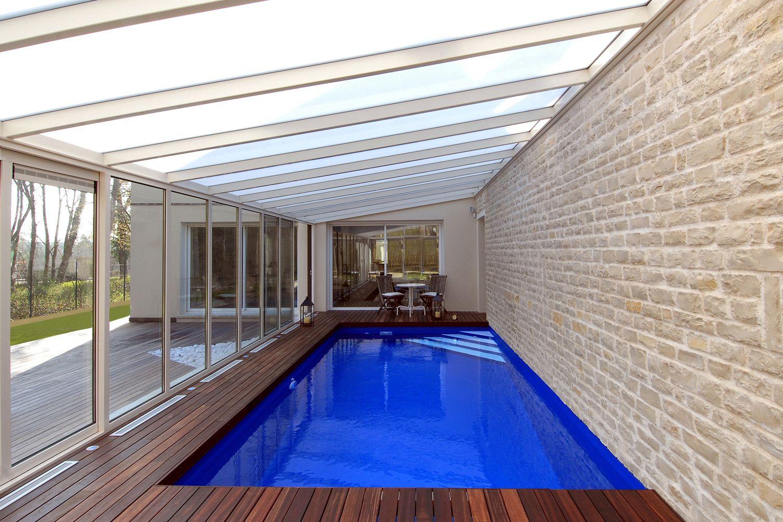 Véranda pour piscine en aluminium avec toiture en 1 pente