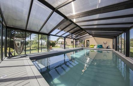 Abri de piscine haut en polycarbonate bronze
