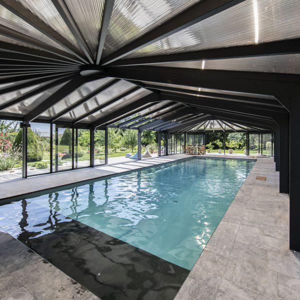 Abri piscine haute de gamme en polycarbonate bronze et double vitrage