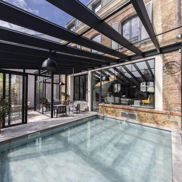 Ensoleillement optimal de la véranda grâce à la toiture en double vitrage